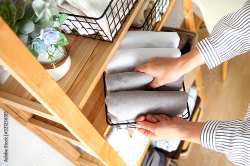 Bed sheets, duvet covers and towels are folded vertically Canvas Print