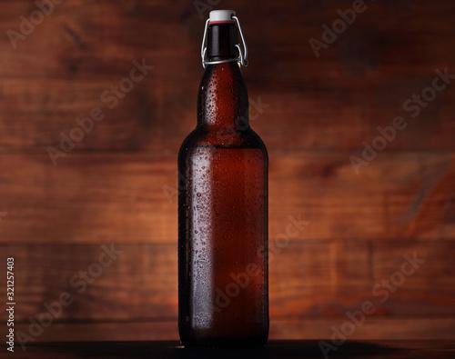 Fototapeta big brown beer bottle with old closure obraz