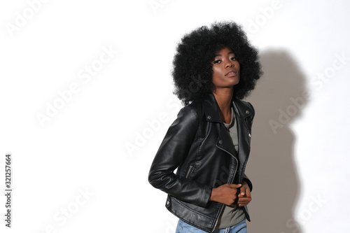 Photo High fashion afro-american model in black leather jacket isolated on white background