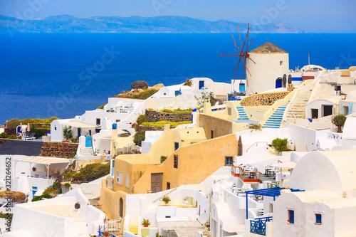 Fototapeta Santorini island, Greece, Oia village windmill, white houses and blue sea panorama obraz