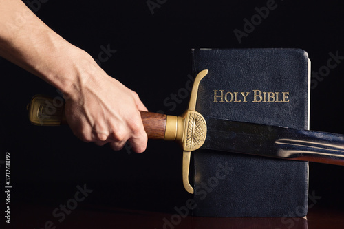 Foto Young Athletic Man with His Bible and Sword