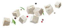 Falling Feta Cubes With Herbs Isolated On White Background