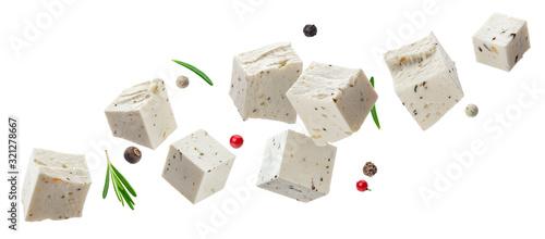Fototapeta Falling feta cubes with herbs isolated on white background obraz