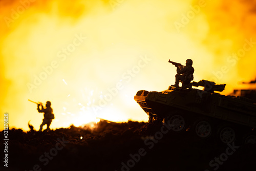 Fototapeta Toy soldiers, tanks and explosion on battleground with fire at background obraz