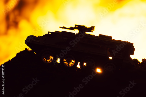 Fototapeta Battle scene with toy tank and fire at background obraz