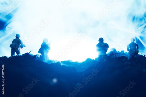 Fototapeta Battle scene with toy warriors in smoke on blue background obraz