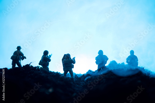 Fototapeta Toy soldiers with weapon and smoke on blue background, battle scene obraz