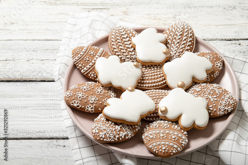 Stampa su Tela Easter cookies on a plate on a wooden background