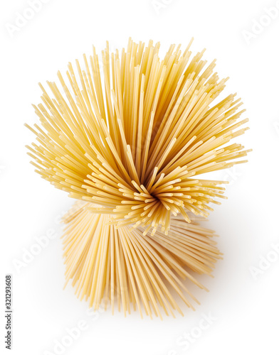 Uncooked dried spaghetti pasta isolated on white background with clipping path Obraz na płótnie