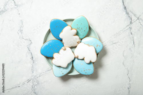 Stampa su Tela Easter cookies in a plate on a concrete background