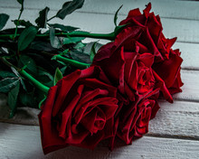 A Bouquet Of Red Roses Covered...