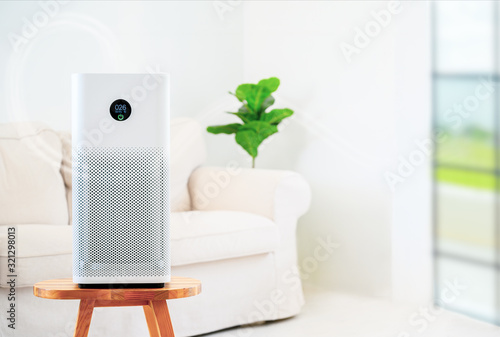air purifier a living room,  air cleaner removing fine dust in house Canvas Print