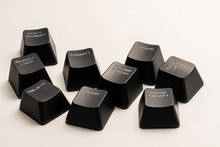 Black Keyboard Buttons With White Inscriptions On A White Background