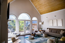 Mid Century Modern Contemporary Style Living Room Den In A Spacious Open Home With A Vaulted Ceiling And A Pine Wood Ceiling And Neutral Gray Couch And Furniture
