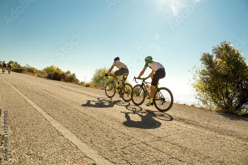 Obraz na plátně bike race in the morning on  uphill road