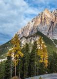 Autumn morning alpine Dolomites mountain scene. Peaceful Valparola Path view, Belluno, Italy.