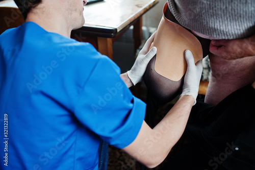 The prosthetist removes the measure from a person with a disability, woman with amputee Canvas Print