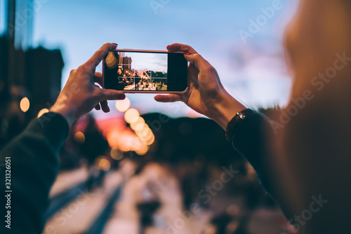 Fotografiet Selective focus on modern cellular phone using for clicking pictures via camera,
