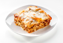 Lasagna Piece Plate With Minced Meat And Melted Cheese Close-up On White Background