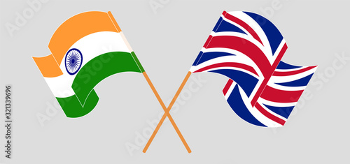 Crossed and waving flags of India and the UK Wallpaper Mural