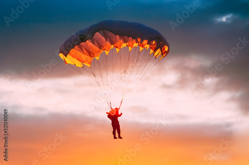Obraz na plátně Skydiver On Colorful Parachute In Sunny Sky