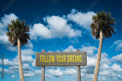 Photo Follow Your Dreams inspirational message for happiness and lifestyle concept