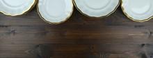 Porcelain Plates On Wooden Bac...