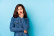canvas print picture - Middle age latin woman isolated on a blue background looking sideways with doubtful and skeptical expression.