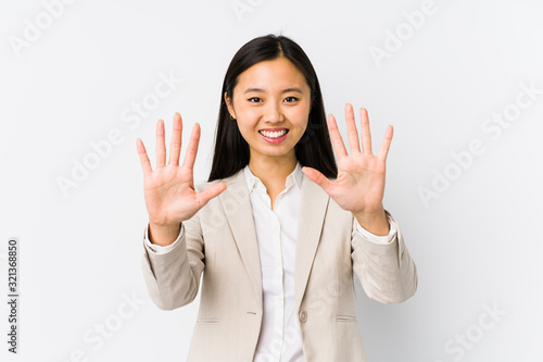 Young chinese business woman isolated showing number ten with hands Canvas Print