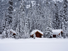 Snow Covered Log Cabins On Lak...