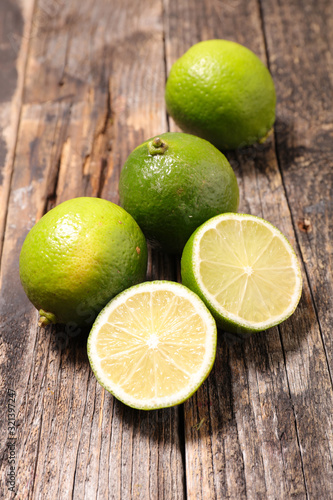 green lemon half on wood background