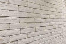 Side View Of Empty White Brick...