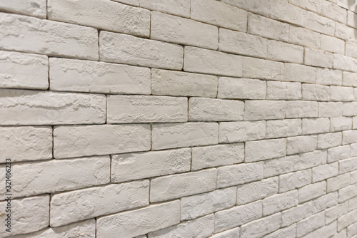Photo side view of empty white brick wall in room