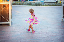 A Little Girl In A Summer Dres...