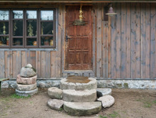 Big Granite Stones Near The  Old Door  Of Ruaral Barn For Storage Of Firewood And Agricultural Tools.