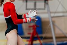 Girl Gymnast In Gymnastics Hand Grips And Gym Chalk