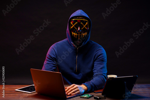 Fototapety, obrazy: hacker committing a crime with the aid of computers and information technology infrastructure, use gadgets for better hack. cyberattack concept