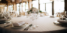 White Table Set For Dinner Wit...