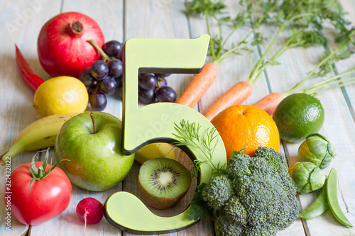 5 Five a day portion size with fresh fruits and vegetables healthy diet lifestyle concept - 321432822
