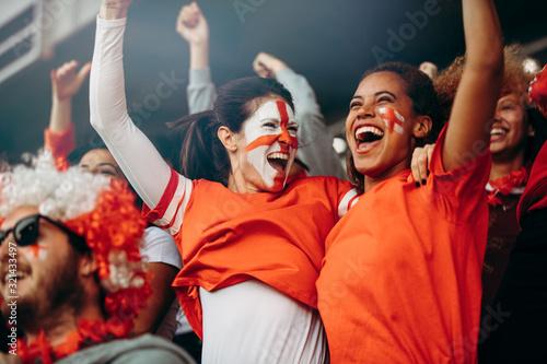 Female soccer fans celebrating championship win Fototapeta