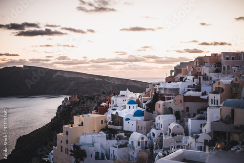 Fototapeta view of whitewashed houses and blue dome in oia Santorini Greece obraz