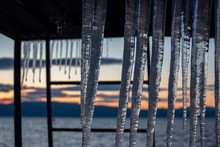 Ice Pendants On A Metal Tower On The Shore Of The Lake At Sunset. Winter Mood. Ohrid Lake, Northern Macedonia.