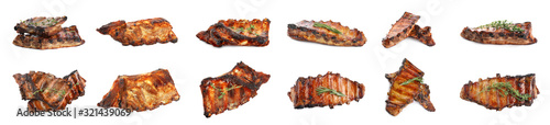 Fototapeta Set of delicious roasted ribs on white background. Banner design