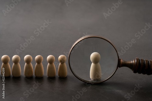 Fototapeta Business & HR global wood puzzle concept for leadership and team with peg doll a