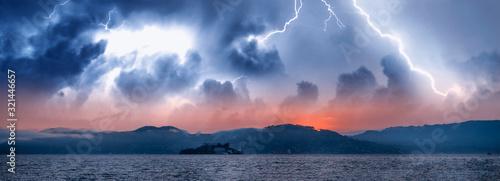 Panoramic view of Alcatraz Island and San Francisco coastline during a storm, Ca Canvas Print