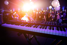 Piano Keys In Purple Light On Concert Stage. Synthesizer.