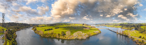 Obraz New Zealand Countryside aerial view at sunset - fototapety do salonu