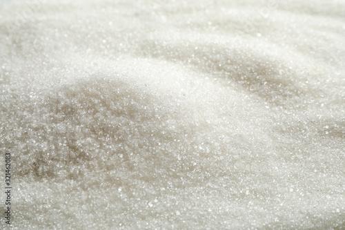 Obraz na plátně Pile of granulated sugar as background, closeup