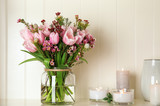 Fototapeta Tulips - Beautiful bouquet with spring pink tulips on shelf