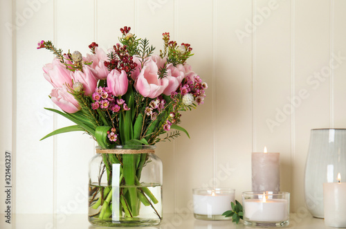 Beautiful bouquet with spring pink tulips on shelf #321463237